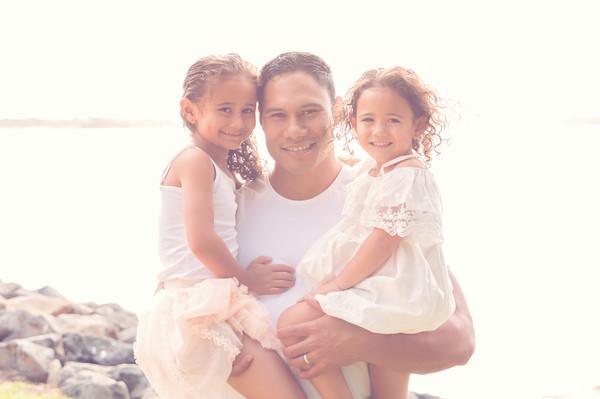 Gorgeous photo of Leni and his girls taken by our Auckland child photographer on location